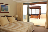 King size bed in bedroom at Pinnacles Resort & Spa